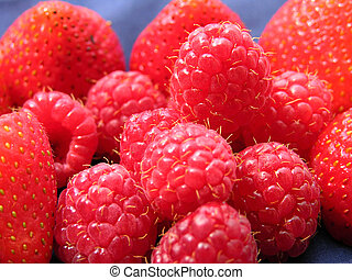 Pile of Berries - Strawberries and raspberries piled...