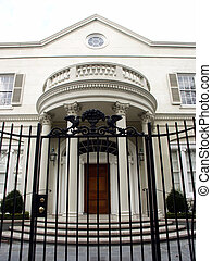 Gated Garden - Iron gate in front of antebellum home