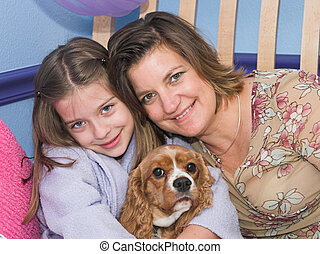The Family Pet - a mother and daughter posing with their...