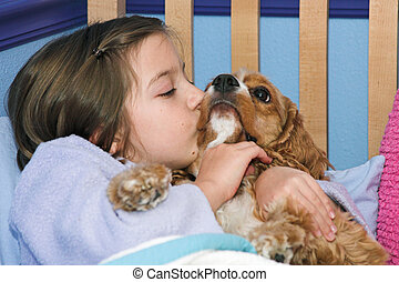 Puppy Kisses - a little girl giving her puppy a kiss...