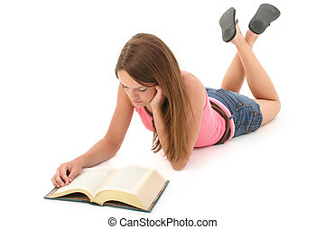 Teen Girl Reading - Fourteen year old teen girl laying on...