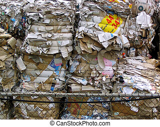 paper recycling - paper products stacked up at a recycling...