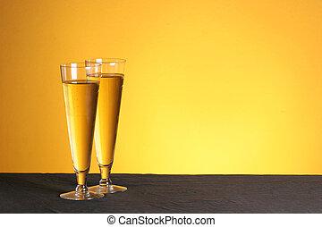 Pilsner pastime - two pilsner glasses on a golden backdrop...