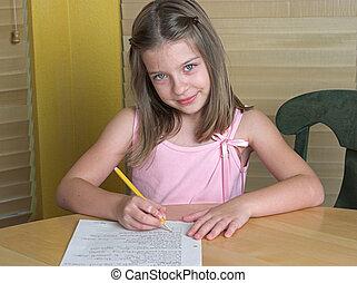 Child Doing Homework - a little girl doing her homework