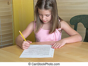 Little Girl Doing Homework - a little girl doing her...