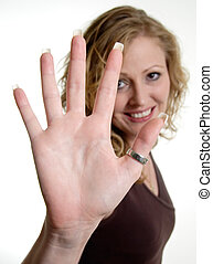 Blonde woman holding up hand