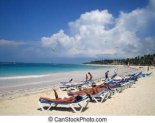 On the beach - Populated beach in the Caribbean, and its...