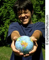 boy and globe - focus on globe, boy with funny face