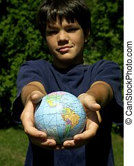 boy and globe 4 - boy holding out globe ,different...