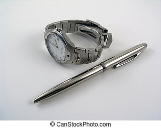 Business watch near a silver ball pen - Watch near a metalic...