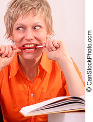 pretty funy woman - Pretty woman with book biting a pen -...