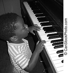 Child Prodigy - Small child playing the piano Black and...