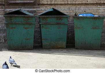 three garbage bins - garbage bins