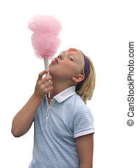 Cotton Candy - A young girl eating cotton candy at a summer...