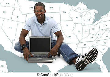Man Computer America - Attractive young man sitting on floor...