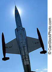 Air jet fighter. - CF-104 Starfighter try to reach the sun.