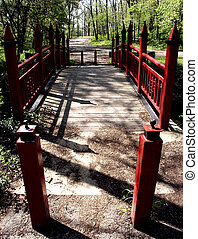 The Red Bridge - Red metal bridge in woods