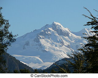 Mountain Peak - Snow-covered mountain peak in full sunshine