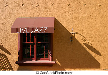 Live Jazz - A Live Jazz awning on a terra cotta colored...