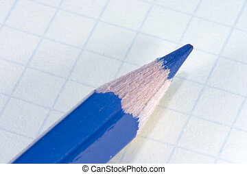 Blue pencil on notepad
