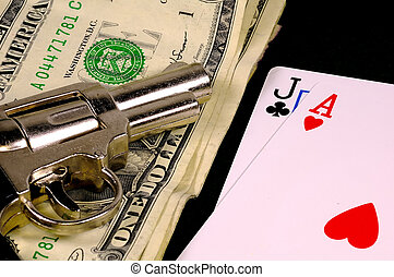 Gamble - Photo of Cards, Money and a Gun.
