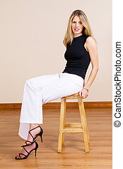 Woman #17 - Beatiful blonde woman sitting on a barstool