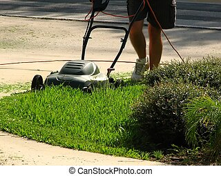 Mowing The Yard - shot of some body mowing the yard.