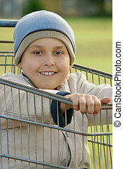 Boy in a Trolley - Boy in an old trolley shopping card