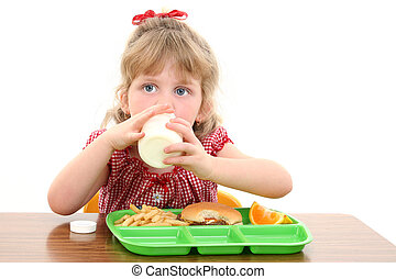 School Lunch Time - Small girl eating lunch at school.