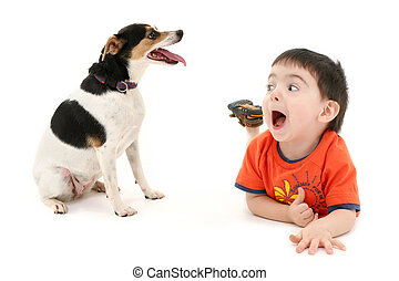 Boy Child Dog - Toddler boy on floor playing with dog. Shot...