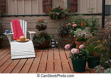 Relaxing Place - An Adirondack chair on a backyard deck with...
