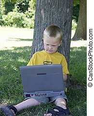 learning boy - child with a laptop learning