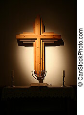 cross with altar - A cross hanging over an altar