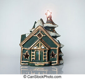 Christmas house - Close up of a little house with a tree