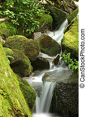 Waterfall - A waterfall with mossy rocks.