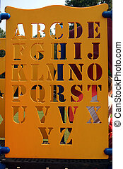 Alphabet - An alphabet cutout on a piece of playground...