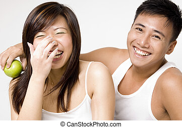 Healthy Couple 6 - A healthy looking asian couple share a...