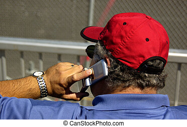 Sports Fan at the Game on the phone