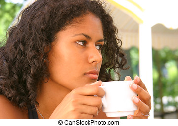 Having a coffee - Beautiful brazilian woman having a coffee