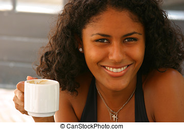 Having a coffee - Beautiful smiling girl having a cup of...