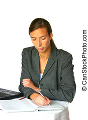 Making notes - Attractive businesswoman making notes