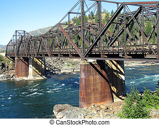 Train Bridge Piers - Metal cladding protects the piers of a...