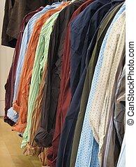 Woven Shirts - Shot of several woven shirts hanging, several...
