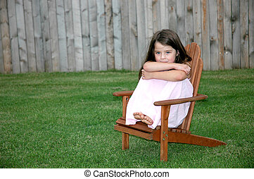 Adorable Five Year Old Girl - Little girl sitting alone in a...