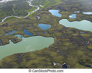 Aerial view on tundra landscape from a helicopter