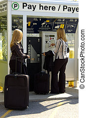 Parking Machine - Two Women Buying a Parking Ticket at the...