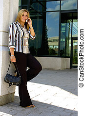 Woman Standing - Attractive Blond Woman Standing Outside Her...