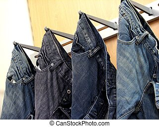 Jeans - shot of a few jeans hanging on display