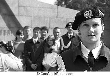 teens in uniform on the Victory Day - girl on sentry duty
