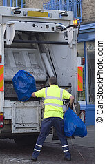 Waste collection - Man in safety clothing collecting plastic...